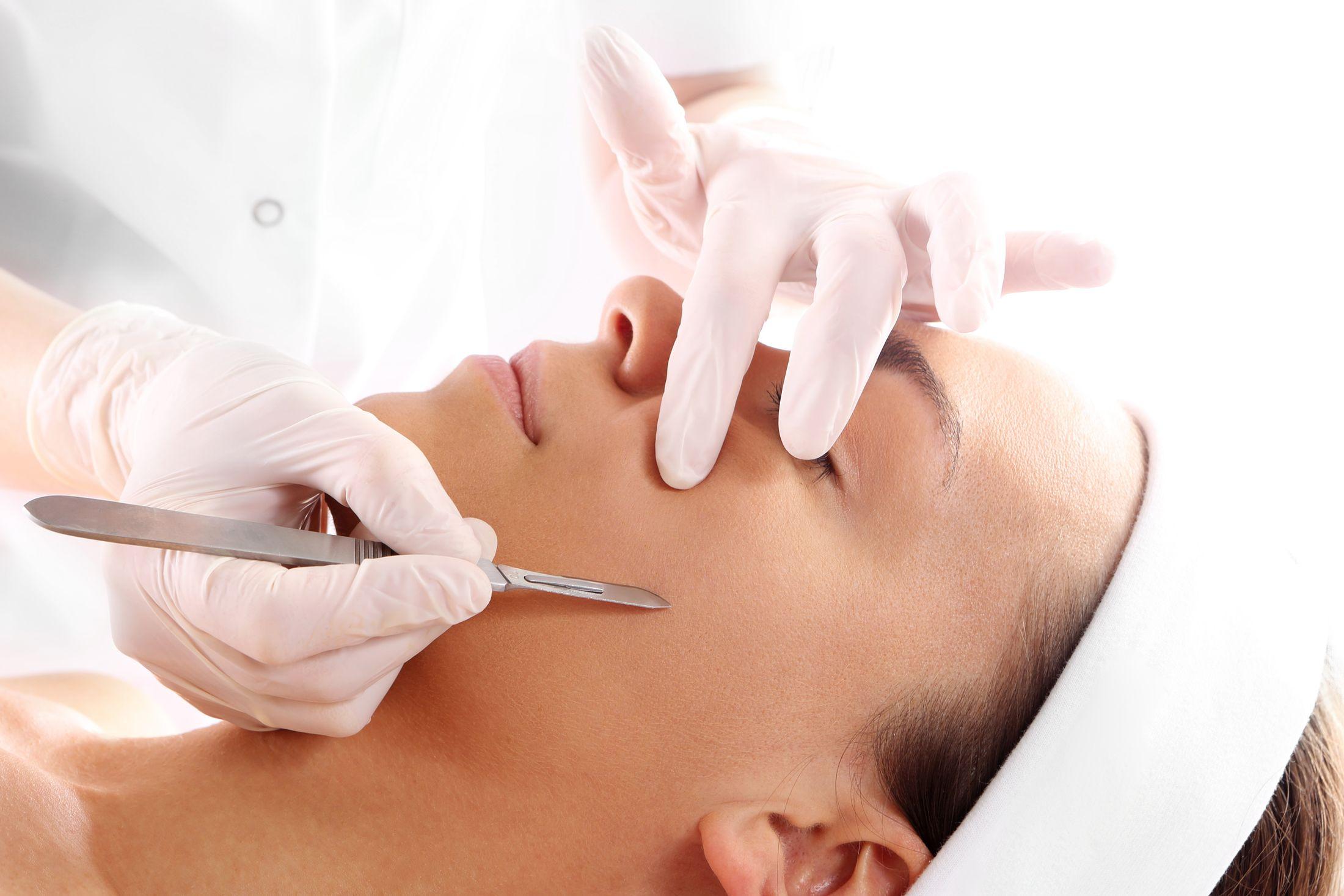Woman receiving dermaplaning